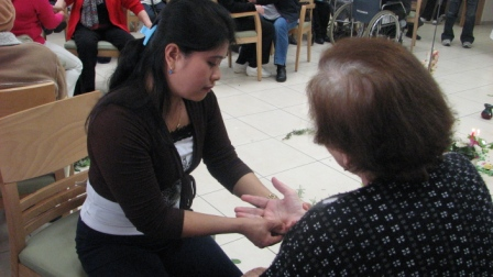 Caregiver giving Hand Reflexology